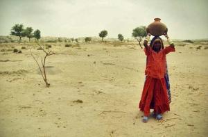 woman carting water