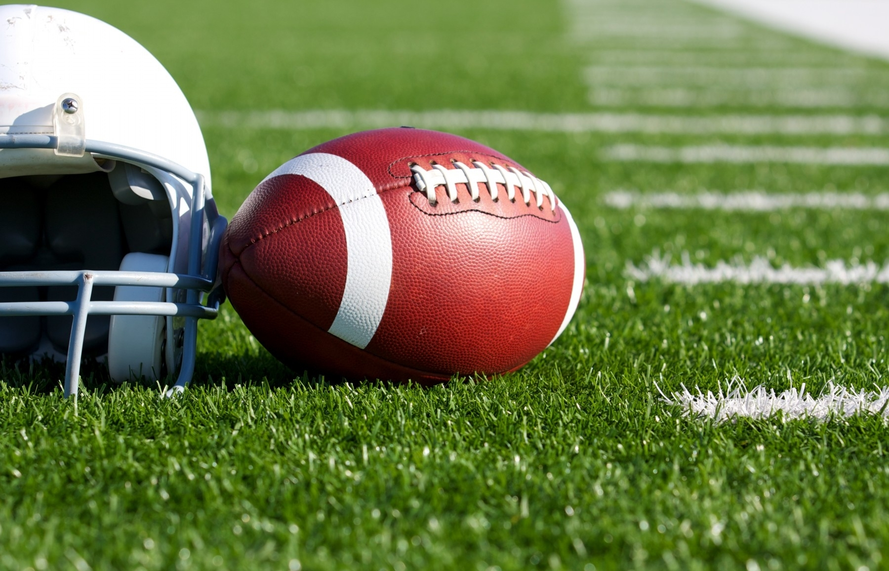 Football-with-Helmet-on-the-Field